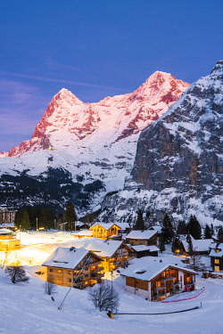 SWI8308AW Mürren, Berner Oberland, canton of Bern, Switzerland. The village with Eiger and Mönch in the backdrop at dusk