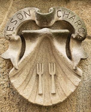 SPA8894AW Spain, Galicia, Santiago de Compostela, resaurant sign with Spain, Galicia, Santiago de Compostela, sign with Scallop shell symbol