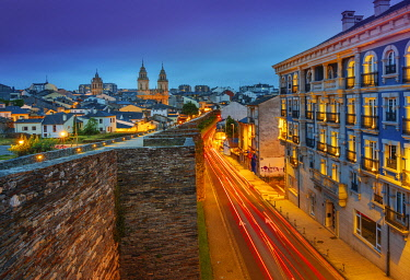 SPA8843AW Spain, Galicia, Lugo Roman walls and cathedral illuminated at night