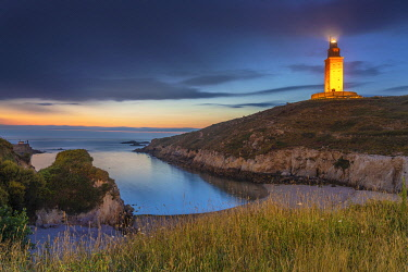 SPA8831AW Spain, Galicia, La Coruna, Torre de Hercules and cove illuminated at night