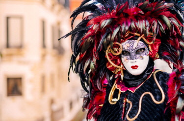 ITA13776AW Venice, Veneto, Italy; A masked character in the city during Carnival