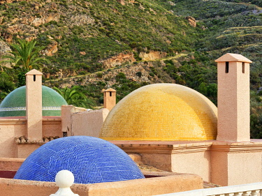 IBXANT04817740 Fireplaces and multicoloured domes on one roof, Cortijo Cabrera, Sierra Cabrera, Almeria, Andalusia, Southern Spain, Spain, Europe