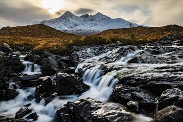 IBXSEI04810703 Waterfall of AltDearg Mor with snow-covered peaks of Marsco and Sgurr Nan Gillean, Sligachan, Portree, Isle of Skye, Scotland, United Kingdom, Europe