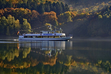 IBLRBA04812310 Excursion boat MS Hennesee in the morning haze, mood at the Hennesee, Hennetalsperre, nature park Sauerland-Rothaargebirge, North Rhine-Westphalia, Germany, Europe