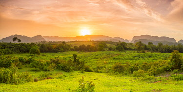 CLKNO101043 Sunset over the tobacco plantations and limestone hills (Mogotes) of the Vinales Valley in Vinales, Pinar del Rio Province, Cuba