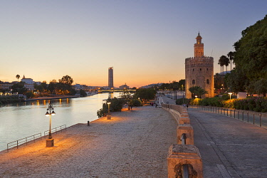 CLKDC99182 Torre del Oro (Tower of Gold) and river Guadalquivir at dusk, Seville, province of Seville, Andalusia, Spain