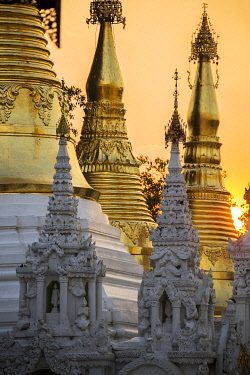CLKMB96678 Sunset behind temples of Shwedagon Pagoda, Yangon, Myanmar