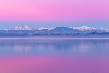 CLKAG98579 Sunrise on Rosa Mount and Alps reflected in Varese lake, Varese province, Lombardy, Italy, Europe