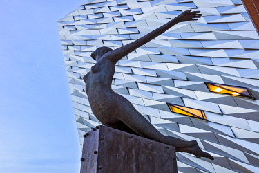 NIR8926 Titanica, a sculpture by Rowan Gillespie, outside the Titanic Maritime Museum designed by the architects Eric Kuhne and Associates, Titanic Quarter, Belfast, Co. Antrim, Northern Ireland, United Kingd...
