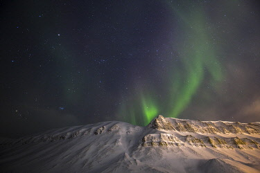 Aurora borealis, the northern lights photographed during the polar night above the mountains near Longyearbyen, Spitsbergen, Svalbard