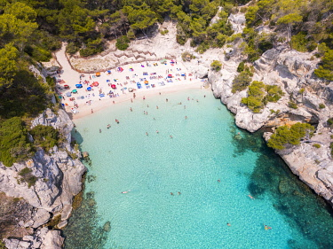 SPA8959AW Aerial view of Cala Macarelleta beach crowded in summer, Menorca, Balearic Islands, Spain