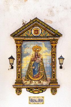 SPA9024AW Religious icon tile work of Virgin Marys, Zahara de la Sierra, Andalusia, Spain