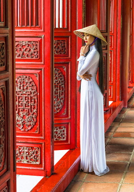 VIT1553AW Young woman wearing traditional national costume, ao dai, in the Imperial City, Hue, Vietnam