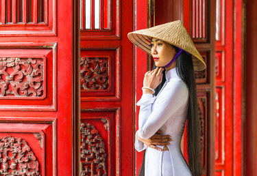 VIT1555AW Young woman wearing traditional national costume, ao dai, in the Imperial City, Hue, Vietnam