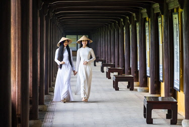 VIT1556AW Young women wearing traditional national costume, ao dai, in the Imperial City, Hue, Vietnam