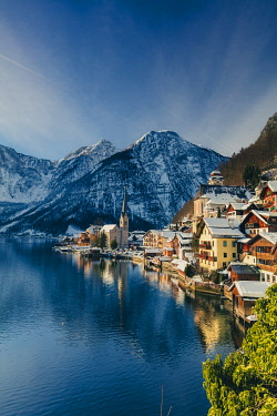 AUT0966AW Typical village called Hallstatt con the Hallstatter see at sunrise with the houses reflecting in the lake