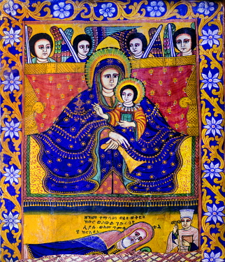 ETH3511 Ethiopia, Aksum, Tigray Region.  A painting of Mary and Jesus in the church of St. Mary of Tsion. Their exceptionally long fingers signify the painting is in the Gondarine style. Jesus is holding the...