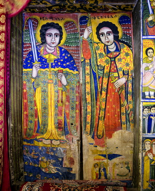 ETH3512 Ethiopia, Aksum, Tigray Region.  The archangels Mikael and Rafael, the protectors of Mary, are painted on the doors leading to the sanctuary of the 17th Century church of St. Mary of Tsion.