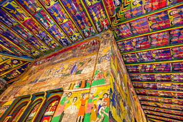 ETH3520 Ethiopia, Aksum, Tigray Region.  The interior of Arbata Entsessa church is a riot of colour.  The ceiling above the east and north walls of the sanctuary is painted with archangels known as kirubel.