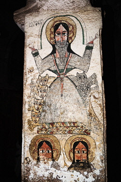 ETH3533 Ethiopia, Maryam Quiat, Tigray Region.  A pillar mural inside Mary Quiat rock-hewn church depicts the Ethiopian Saint Gebre Manfus Qeddus. In Ethiopian iconography, he is covered with hair with lions...
