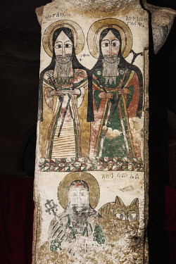 ETH3534 Ethiopia, Maryam Quiat, Tigray Region.  A pillar mural painted on cloth inside Mary Quiat rock-hewn church depicts Abuna Yohannes and his pupil Abuna Gabre Nazrawi and below them, Abba Samuel riding h...