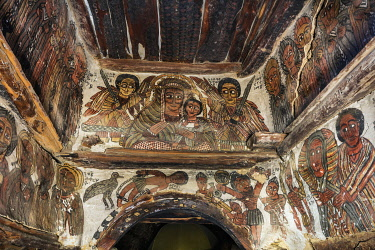 ETH3544 Ethiopia, Takatisfi, Tigray Region, Petros & Paulos church.  The eyes of the Archangels Mikael and Rafael are focused on Mary and Jesus in this fresco on the arch leading to the sanctuary.