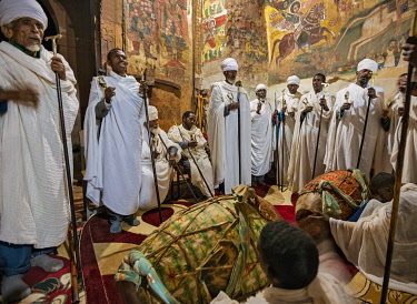 ETH3572 Ethiopia, Abraha Atsbeha, Tigray Region.  Priests chant with their sistras to the accompaniment of drums in the rock-hewn church of Abraha wa- Atsbeha during a midnight mass to celebrate Enkutatash, t...