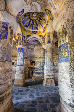 ETH3580 Ethiopia, Gheralta Mountains, Tigray Region.  The attractive transept of the ancient rock-hewn church of Abuna Gebre Mikael with its beautiful blue and yellow frescoes.