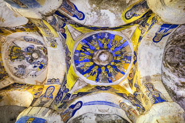 ETH3582 Ethiopia, Gheralta Mountains, Tigray Region.  The central dome of the ancient rock-hewn church of Abuna Gebre Mikael with its beautiful blue and yellow frescoes depicting twelve Elders of the Apocalyp...