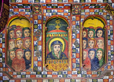 ETH3618 Ethiopia, Mekele, Tigray Region.  A beautifully painted blind triple window in the eighteenth century church of Selassie Chelakot depicts Mary, the holy virgin, flanked by holy virgins worthy of enter...