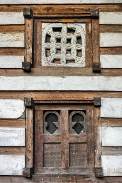 ETH3656 Ethiopia, Lasta, Amhara Region. Two windows on the facade of the beautifully preserved twelfth century church of Yemrehanna Kristos. The variety of  their designs provides both decorative elegance and...