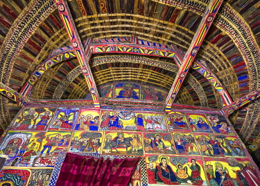 ETH3702 Ethiopia, Lake Tana, Amhara Region. The traditional roof of Betre Maryam Church has attractive bands of papyrus while the beams and walls of thesanctuary are painted with biblical scenes in vibrant co...
