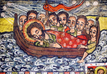 ETH3707 Ethiopia, Lake Tana, Amhara Region. A wall mural in the Church at Debre Selassie Monastery. Jesus sleeps while crossing the Sea of Galilee before  calming the stormy waters. The anxious Apostles look...