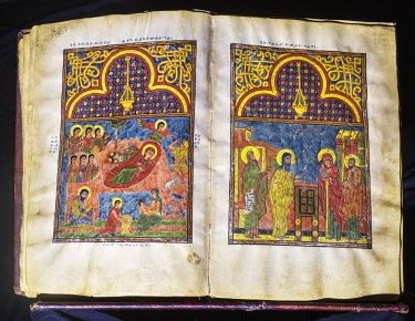 ETH3719 Ethiopia, Lake Tana, Amhara Region. A magnificent sixteenth or seventeenth century illustrated bible is kept at Kibran Gabriel Monastery, the holiest of the Lake Tana monasteries. These pages show The...