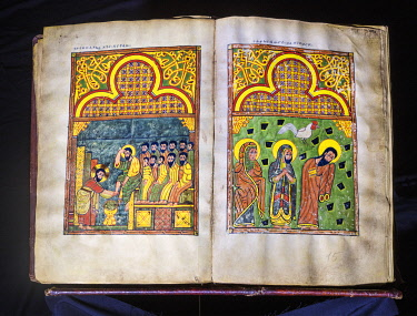 ETH3721 Ethiopia, Lake Tana, Amhara Region. A magnificent sixteenth or seventeenth century illustrated bible is kept at Kibran Gabriel Monastery, the holiest of the Lake Tana monasteries. These pages show Jes...