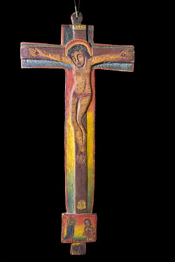 ETH3723 Ethiopia, Lake Tana, Amhara Region. A very old richly decorated one-metre- high wooden cross is kept in the Treasury at Kibran Gabriel Monastery, the holiest of the Lake Tana monasteries.  On its fron...