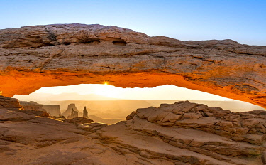 IBXMAB04853441 View through Natural Arch, Mesa Arch, Sunrise, Grand View Point Road, Island in the Sky, Canyonlands National Park, Moab, Utah, USA, North America