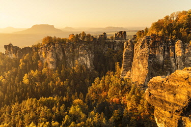 IBXMAL04832710 Sunrise at the Bastei Bridge, Bastei near Rathen, Elbe Sandstone Mountains, National Park Saxon Switzerland, Saxony, Germany, Europe