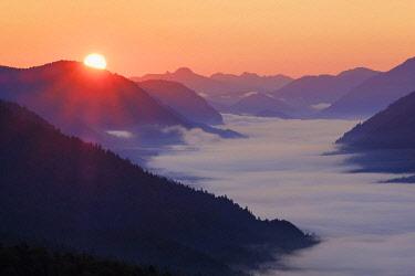 IBXMAN04830511 View from Krepelschrofen at sunrise on mountain ranges, Isar valley in fog, Wallgau, Werdenfelser Land, Upper Bavaria, Bavaria, Germany, Europe
