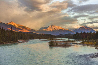 IBXMMW04836167 View to a valley with river, Icefields Parkway, Athabasca River, Jasper National Park, back mountains, evening mood, Alberta, Canada, North America