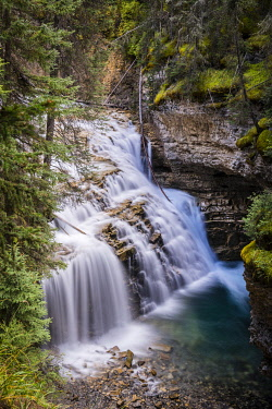 IBXMMW04845271 Waterfall running in cascades, mountain river in a gorge, Johnston Creek in Johnston Canyon, Bow Valley, Banff National Park, Rocky Mountains, Alberta, Canada, North America