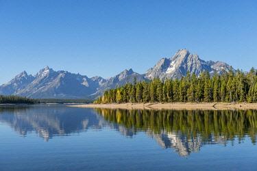 IBXMMW04850450 Mountains reflected in a lake, Colter Bay Bay, Jackson Lake, Teton Range Mountain Range, Grand Teton National Park, Wyoming, USA, North America