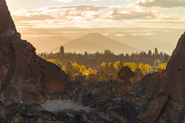 IBXMMW04859951 Sunset, view over rocks to Mount Mt Hood in the distance, Smith Rock State Park, Oregon, USA, North America