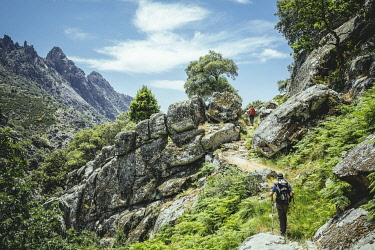 IBLFBA04695178 Hikers in rocky landscape, Sierra de Gredos, Extremadura, Castile and Leon, Spain, Europe