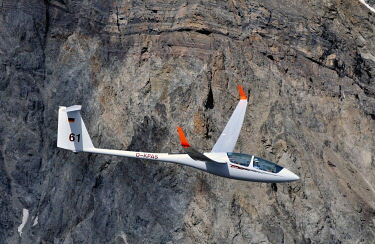IBLHWE04859240 Glider of type ASH25 in front of a rock face in the mountains, Haute Alpes, France, Europe