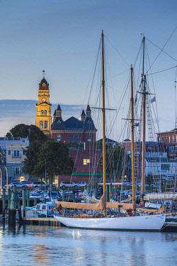 US03737 USA, New England, Massachusetts, Cape Ann, Gloucester, Gloucester Schooner Festival, schooners in Gloucester Harbor, dusk