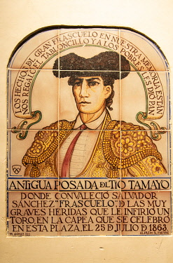 SPA9068AW A tilework depicting a famous bullfighter (torero) that was hurt by a wild bull during a bullfight in the 19th century. Plaza Mayor, Chinchon. Castilla la Mancha, Spain