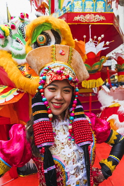 TPX69770 England, London, Chinatown, Chinese New Year Parade, Female Parade Participant in Colourful Chinese Costume