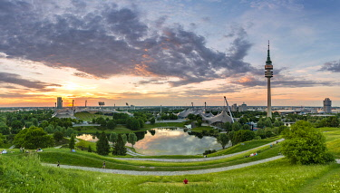 IBLMAB04847974 Olympic grounds at sunset, park with Olympic lake and television tower, Olympic tower, Theatron, Olympic park, Munich, Upper Bavaria, Bavaria, Germany, Europe