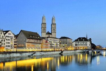 IBLMKL01858591 Limmat river, Limmatquai quay with Zunfthaus zum Rueden guildhall, Grossmuenster great minster and Helmhaus building at the blue hour in the old town of Zurich, Canton Zurich, Switzerland, Europe